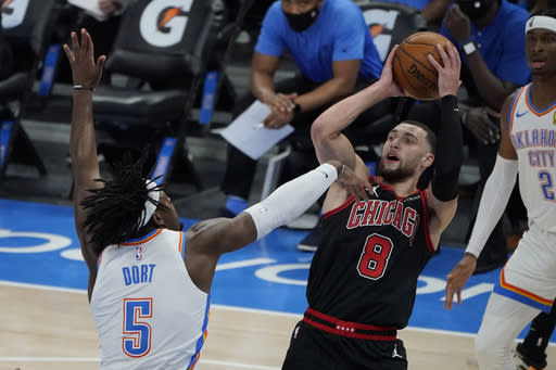 Chicago Bulls guard Zach LaVine (8) shoots as Oklahoma City Thunder forward Luguentz Dort (5) defends during the first half of an NBA basketball game Friday, Jan. 15, 2021, in Oklahoma City. (AP Photo/Sue Ogrocki)