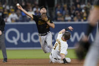 Pittsburgh Pirates second baseman Adam Frazier throws to first to complete the double play as San Diego Padres' Jake Cronenworth slides at second during the sixth inning of a baseball game Wednesday, May 5, 2021, in San Diego. Fernando Tatis Jr. was out at first. (AP Photo/Gregory Bull)