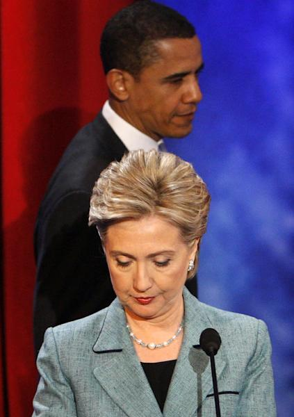 """FILE - In this April 16, 2008 file photo, Democratic presidential hopefuls, Sen. Hillary Rodham Clinton, D-N.Y., and Sen. Barack Obama, D-Ill., return from a commercial break during their debate at the National Constitution Center, in Philadelphia. In presidential politics, everybody's searching for """"the moment."""" The campaigns don't know when or how it will come, but they watch for something _ awkward words or an embarrassing image _ that can break through and become the defining symbol of the other guy's flaws. Now all eyes are on the series of three presidential debates that starts Wednesday. (AP Photo/Charles Dharapak, File)"""