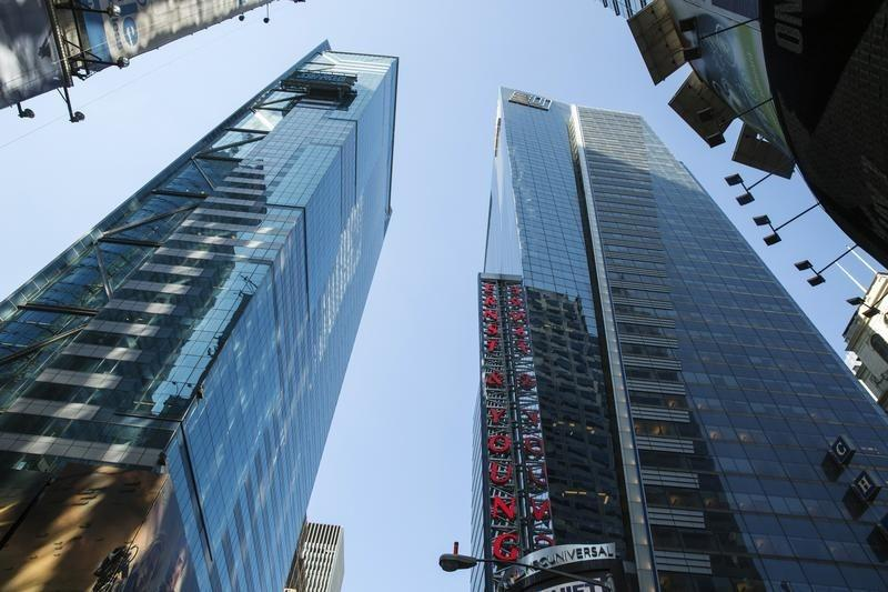 The Ernst & Young building rises above Times Square in New York