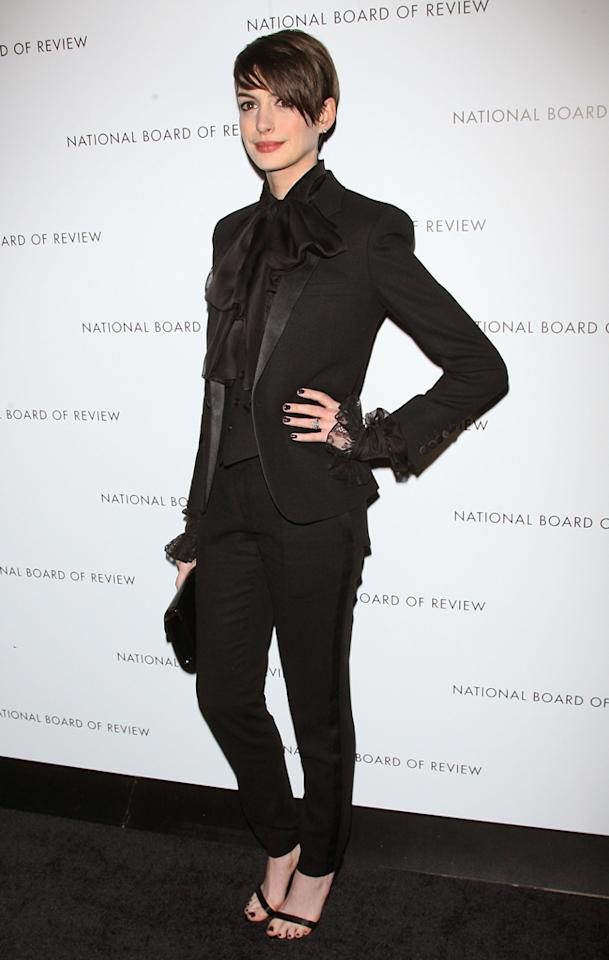 """Les Mis"" star Anne Hathaway debuted a daring, goth-glam look upon arriving at the  National Board of Review Awards in NYC on Tuesday evening. The  frontrunner for Best Supporting Actress probably won't opt for such an  edgy ensemble come Oscar night, but we'd certainly love to see more of  her in Givenchy sandals and menswear-inspired outfits, such as this  lace-accented looker courtesy of Saint Laurent. (1/8/2013)"