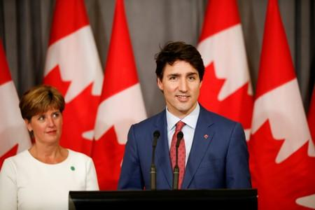 FILE PHOTO: Canada's Prime Minister Justin Trudeau and Canada's Minister for International Development Marie-Claude Bibeau attend a news conference at Canada's Embassy in London