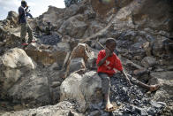 Kevin Mutinda, 7, works breaking rocks with a hammer along with his older sisters and mother, who says she was left without a choice after she lost her cleaning job at a private school when coronavirus pandemic restrictions were imposed, at Kayole quarry in Nairobi, Kenya Tuesday, Sept. 29, 2020. The United Nations says the COVID-19 pandemic risks significantly reducing gains made in the fight against child labor, putting millions of children at risk of being forced into exploitative and hazardous jobs, and school closures could exacerbate the problem. (AP Photo/Brian Inganga)