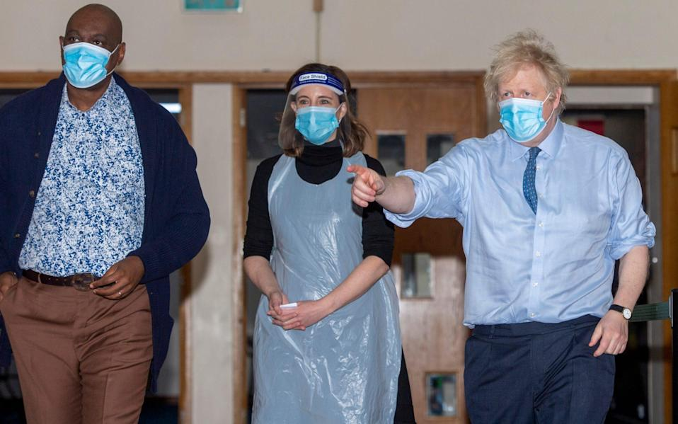 he Prime Minister Boris Johnson visits a vaccination centre at a North London church