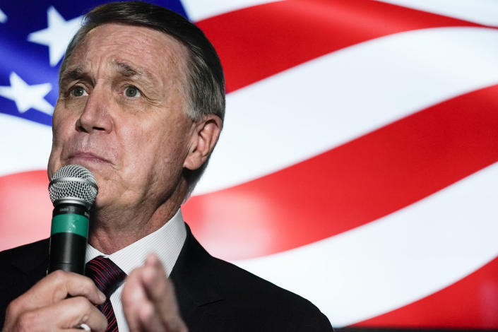 FILE - Republican candidate for U.S. Senate Sen. David Perdue speaks during a campaign rally on Friday, Nov. 13, 2020, in Cumming, Ga. As Georgia becomes the nation's political hotspot this winter before twin runoff elections Jan. 5 that will determine control of the Senate, faith-based organizing is heating up. Conservative Christians are rallying behind Republican Perdue and Sen. Kelly Loeffler, while Black churches and liberal-leaning Jewish groups are backing Democratic challengers Rev. Raphael Warnock and Jon Ossoff. (AP Photo/Brynn Anderson)