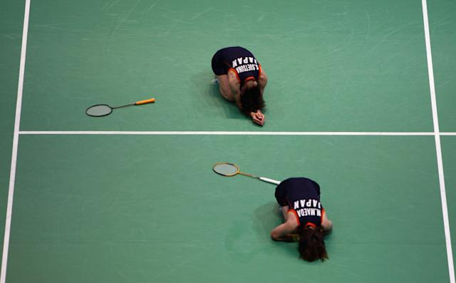 BEIJING - AUGUST 11: Miyuki Maeda and Satoko Suetsuna of Japann celebrate after match point during their Women's Doubles match against Wei Yang and Jiewen Zhang of China at the Beijing University of Technology Gymnasium on Day 3 of the Beijing 2008 Olympic Games on August 11, 2008 in Beijing, China. (Photo by Michael Steele/Getty Images)