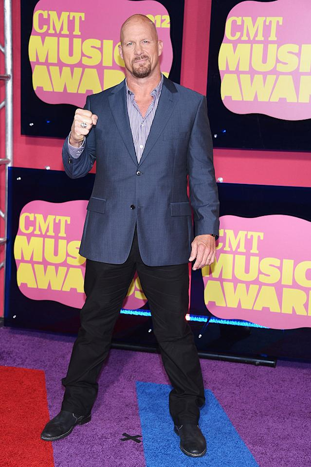 "Former WWE wrestler ""Stone Cold"" Steve Austin put on not just a shirt, but an entire suit for the ceremony! After all, Austin, who's now the host of CMT's reality competition ""Redneck Island,"" was a presenter."