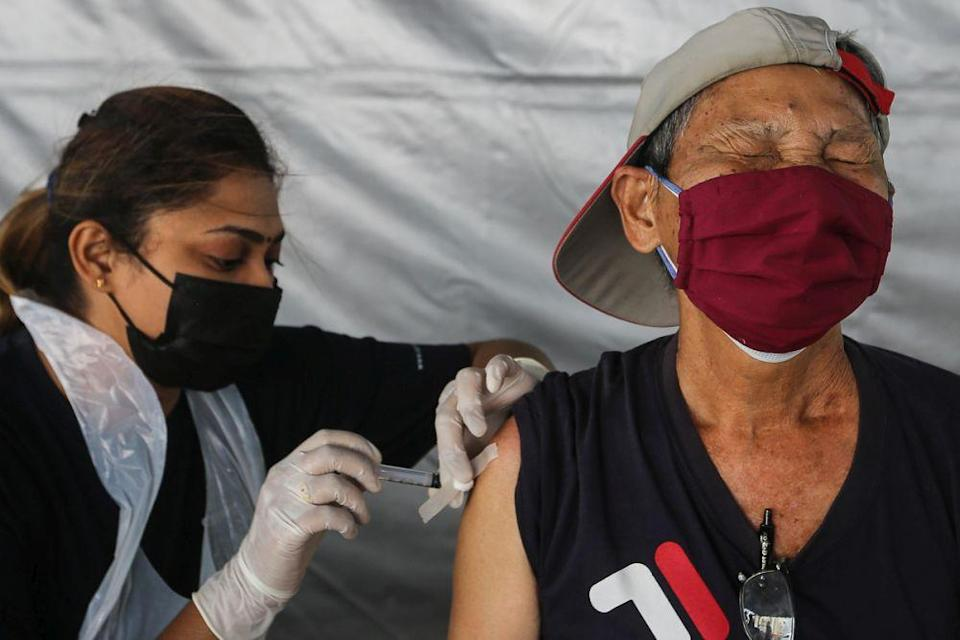 Members of the public receive their Covid-19 shot through the MYMedic@Wilayah Vaccine Mobile Truck programme at PPR Sg. Bonus in Setapak, Kuala Lumpur June 21, 2021. — Picture by Yusof Mat Isa