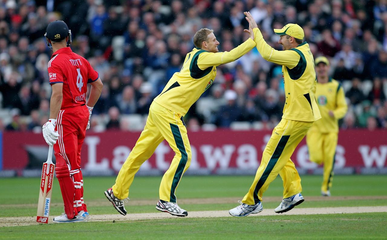 Australia's Adam Voges (left) celebrates taking the wicket of England's Joe Root with Shaun March (right) during the Third One Day International at Edgbaston, Birmingham.