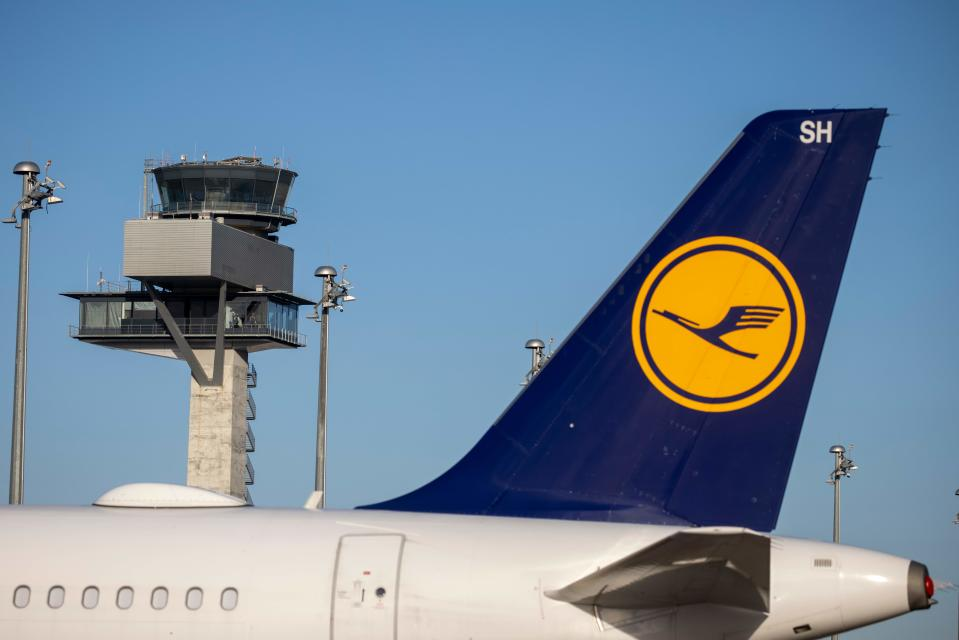 """The logo of German airline Lufthansa can be seen on an aircraft parked at the """"Berlin Brandenburg Airport Willy Brandt"""" in Schoenefeld, southeast of Berlin, on November 4, 2020. - The airport's southern runway received it's first arrival, making the facility fully operational. (Photo by Odd ANDERSEN / AFP) (Photo by ODD ANDERSEN/AFP via Getty Images)"""
