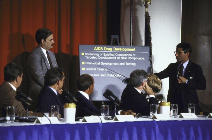 Dr. Anthony Fauci, far right, giving a presentation to President Ronald Reagan, far left, and other members of the President's Commission on AIDS. (Diana Walker/LIFE Images Collection via Getty Images)