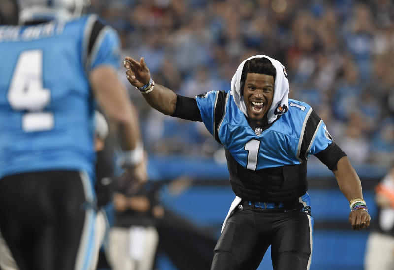 Carolina Panthers' Cam Newton (1) celebrates from the sidelines after a play against the New England Patriots during the second half of a preseason NFL football game in Charlotte, N.C., Friday, Aug. 24, 2018. (AP Photo/Mike McCarn)