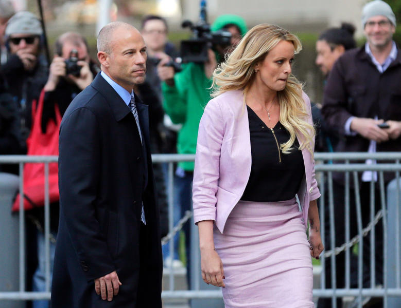 FILE - In this April 16, 2018 file photo, Stormy Daniels, right, and her attorney Michael Avenatti turn from the microphones after speaking as they leave federal court in New York. Avenatti, the trash-talking lawyer who became a household name by representing a porn star and hounding Donald Trump, is now in the legal fight of his life against federal charges that could send him to prison for the rest of his life. (AP Photo/Seth Wenig, File)