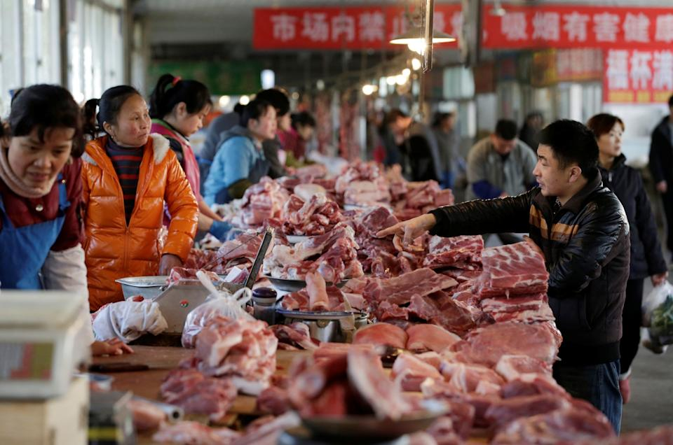 Meat stalls are seen at a market in Beijing, China: REUTERS
