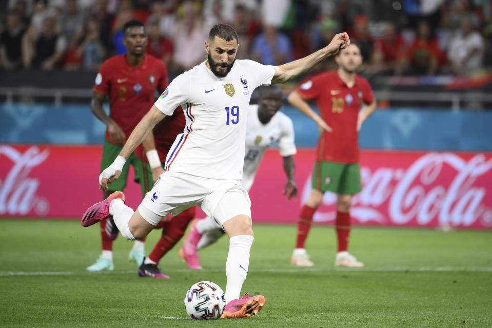 France's Karim Benzema scores his side's first Goa; from the penalty spot during the Euro 2020 soccer championship group F match between Portugal and France at the Puskas Arena in Budapest, Wednesday, June 23, 2021. (Franck Fife, Pool photo via AP)