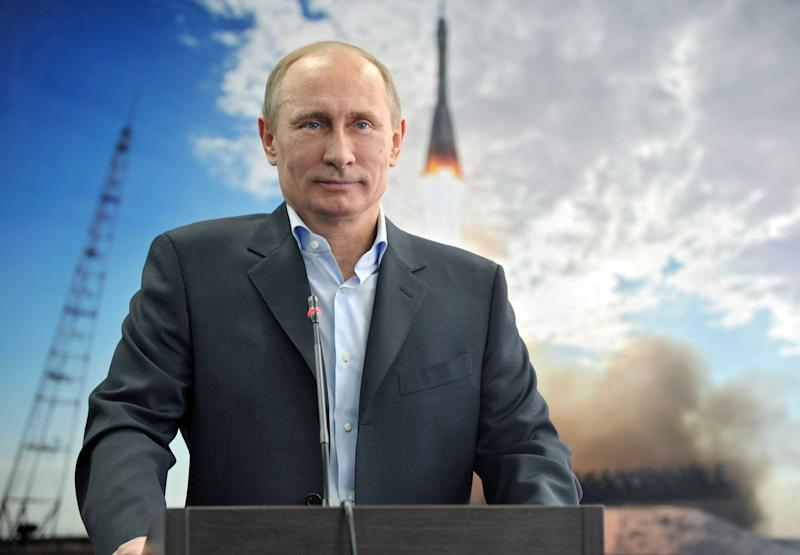 Russian President Vladimir Putin listens during a live video link with the International Space Station from a construction site of new cosmodrome Vostochny ( Eastern) at Eastern Siberia on Friday, April 12, 2013. Russia celebrates 52nd anniversary of the first manned space flight on April 12. Putin said on Friday Russia would continue to lease the Baikonur space complex in Kazakhstan despite recent statements from space officials that Russia may suspend its lease. (AP Photo/RIA Novosti, Alexei Nikolsky, Presidential Press Service)