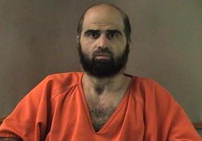 FILE - This undated file photo provided by the Bell County Sheriff's Department shows Nidal Hasan, the Army psychiatrist charged in the deadly 2009 Fort Hood shooting rampage that left 13 dead. A military judge said Friday, June 14, 2013, that she will not allow Hasan to tell jurors that he shot Fort Hood soldiers to protect Taliban leaders in Afghanistan. Col. Tara Osborn said that Hasan's defense of others strategy fails as a matter of law. (AP Photo/Bell County Sheriff's Department, File)