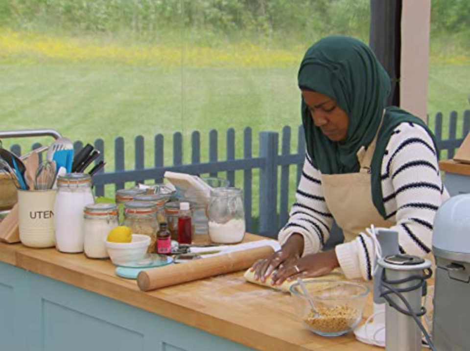 """<p>The show films each episode over two days, which means that contestants are required to wear the <a href=""""https://www.delish.com/food-news/a34672933/great-british-baking-show-have-to-wear-same-clothes/"""" rel=""""nofollow noopener"""" target=""""_blank"""" data-ylk=""""slk:same outfit both days"""" class=""""link rapid-noclick-resp"""">same outfit both days</a>.</p>"""