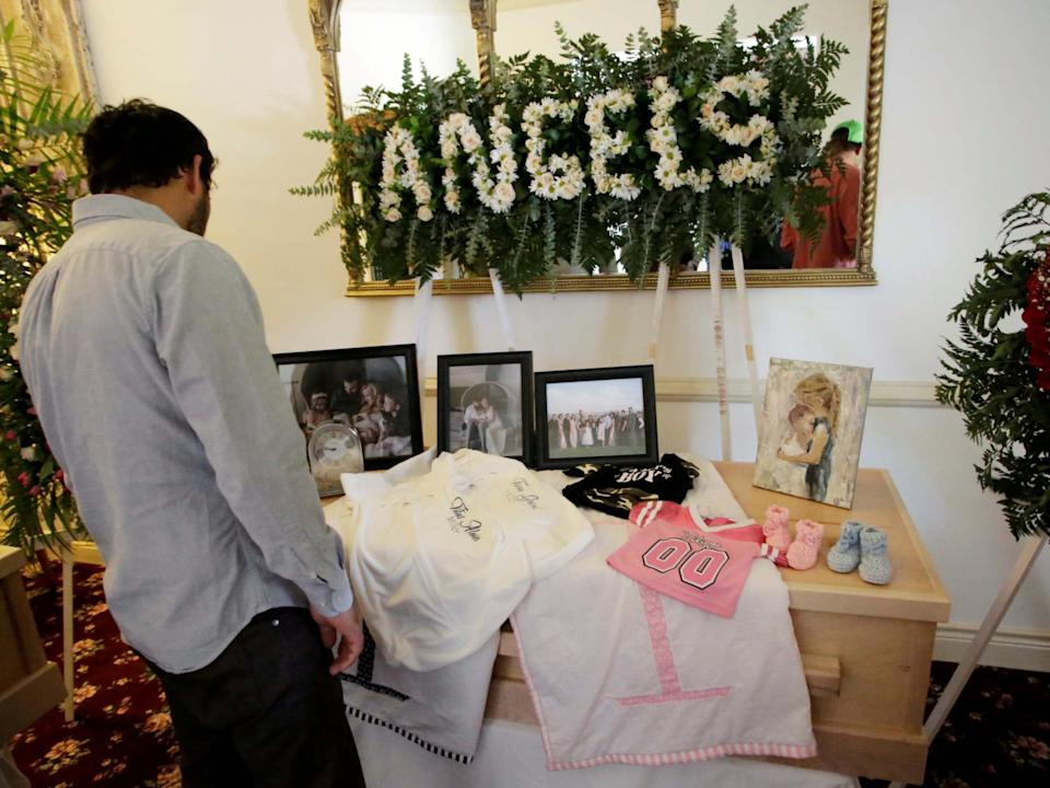 A person observes framed photographs of Rhonita Maria Miller and her four children, members of the Mexican-American Mormon community killed by unknown assailants, before her funeral in La Mora, in La Mora, Sonora state, Mexico 7 November 2019: REUTERS