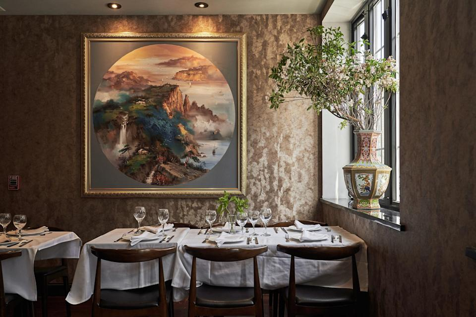 """On the corner of Mott and Mosco, down a dark flight of stairs, unassuming neighborhood stalwart <a href=""""http://www.hop-kee-nyc.com/"""" rel=""""nofollow noopener"""" target=""""_blank"""" data-ylk=""""slk:Hop Kee"""" class=""""link rapid-noclick-resp""""><strong>Hop Kee</strong></a> has been serving up no-frills Cantonese fare since 1968—but the lack of fuss is exactly why you go (and why Anthony Bourdain loved it). Slide into a booth and order the crabs Cantonese style, served in a rich brown sauce, and the salted squid with spicy green pepper. Over on East Broadway, <a href=""""http://hwayuannyc.com/"""" rel=""""nofollow noopener"""" target=""""_blank"""" data-ylk=""""slk:Hwa Yuan Szechuan"""" class=""""link rapid-noclick-resp""""><strong>Hwa Yuan Szechuan</strong></a>'s white tablecloths are great for a dressed-up family dinner or a Friday night on the town; for something more low-key, <a href=""""http://www.noodlevillage.com/"""" rel=""""nofollow noopener"""" target=""""_blank"""" data-ylk=""""slk:Noodle Village"""" class=""""link rapid-noclick-resp""""><strong>Noodle Village</strong></a> on Mott is the perfect casual spot to roll into around 4 p.m. on a Saturday for steaming bowls of pork wonton noodle soup. On Doyers, <a href=""""https://www.cntraveler.com/restaurants/new-york/nom-wah-tea-parlor?mbid=synd_yahoo_rss"""" rel=""""nofollow noopener"""" target=""""_blank"""" data-ylk=""""slk:Nom Wah Tea Parlor"""" class=""""link rapid-noclick-resp""""><strong>Nom Wah Tea Parlor</strong></a> has been open since 1920, making it the oldest continuously running restaurant in Chinatown—and it's still buzzing today, with locals and visitors who pack in each weekend for dim sum staples like shrimp shumai and Shanghainese soup dumplings. By contrast, <strong>Mee Sum Cafe</strong> on Pell Street feels like a place that time forgot, with hulking dun-colored cash register and metal barstools crowned with burnt-orange leather. Order one of the banana-leaf-encased sticky rice bundles, which sit by the dozens in trays on the counter, and a whole fish, marinated in soy sauce and scallions, if """
