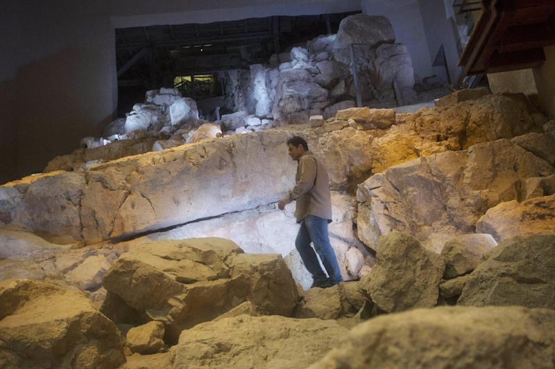 In this Thursday, May 1, 2014, photo, Eli Shukron, an archeologist formerly with Israel's Antiquities Authority, walks in the City of David archaeological site near Jerusalem's Old City. Shukron, who excavated at the site for nearly two decades, says he has found the legendary citadel captured by King David in his conquest of Jerusalem. But archaeologists are divided on identifying Davidic sites in Jerusalem, the city he is said to have made his capital. (AP Photo/Sebastian Scheiner)