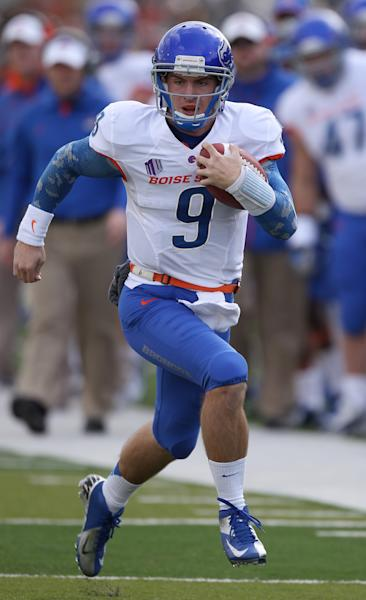 Boise State's Grant Hedrick (9) runs down the sideline against Nevada's defense during the first half of a NCAA college football game on Saturday, Dec. 1, 2012, in Reno, Nev. (AP Photo/Cathleen Allison)