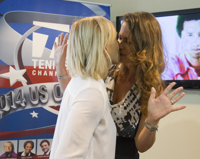 Tennis legend Martina Navratilova proposes to Russian businesswoman Julia Lemigova in the Tennis Channel suite at the U.S. Open Saturday (Susan Mullane-USA TODAY Sports)