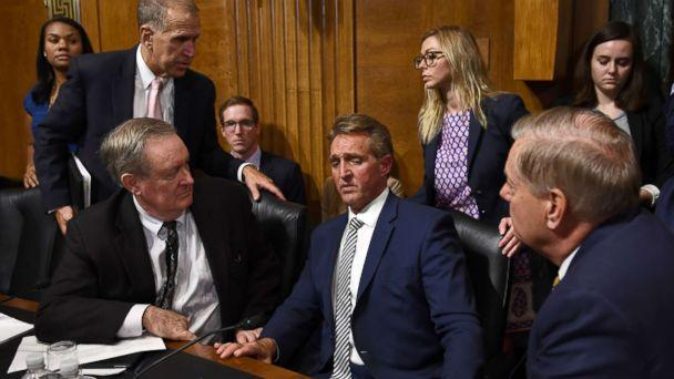 Senate Judiciary Committee member Sen. Jeff Flake speaks with committee colleagues during a hearing in Washington on Sept. 28, 2018, after requested a delay for a floor vote to allow for an FBI investigation. (Brendan Smialowski/AFP/Getty Images)