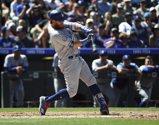 Los Angeles Dodgers' Justin Turner gets a hit off Colorado Rockies starting pitcher Tyler Anderson to reach base on a fielding error by left fielder Matt Holliday in the second inning of a baseball game Sunday, Sept. 9, 2018, in Denver. (AP Photo/John Leyba)