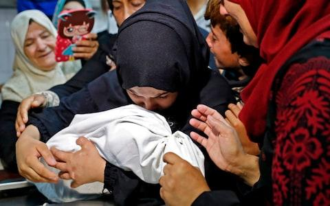 The mother of a Leila al-Ghandour, a Palestinian baby of 8 months who according to the Palestinian health ministry died of tear gas inhalation during clashes  - Credit: THOMAS COEX/ AFP