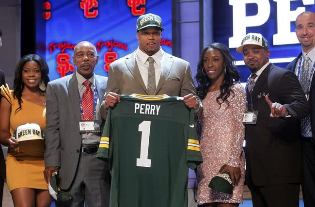 Southern California's Nick Perry poses for photographs with loved ones after being selected 28th overall by the Green Bay Packers in the first round of the NFL football draft at Radio City Music Hall, Thursday, April 26, 2012, in New York. (AP Photo/Jason DeCrow)