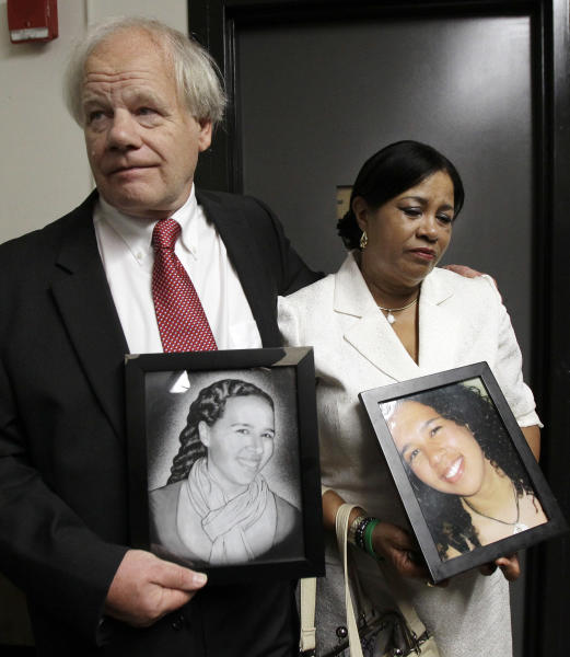 Nicolas and Virginia Payne, of New Milford, Conn., react as they hold pictures of their slain daughter, Rebecca, outside a Suffolk Superior Courtroom in Boston, Monday, June 18, 2012, after Cornell Smith, 30, was arraigned on first-degree murder charges in her shooting death. (AP Photo/Elise Amendola)