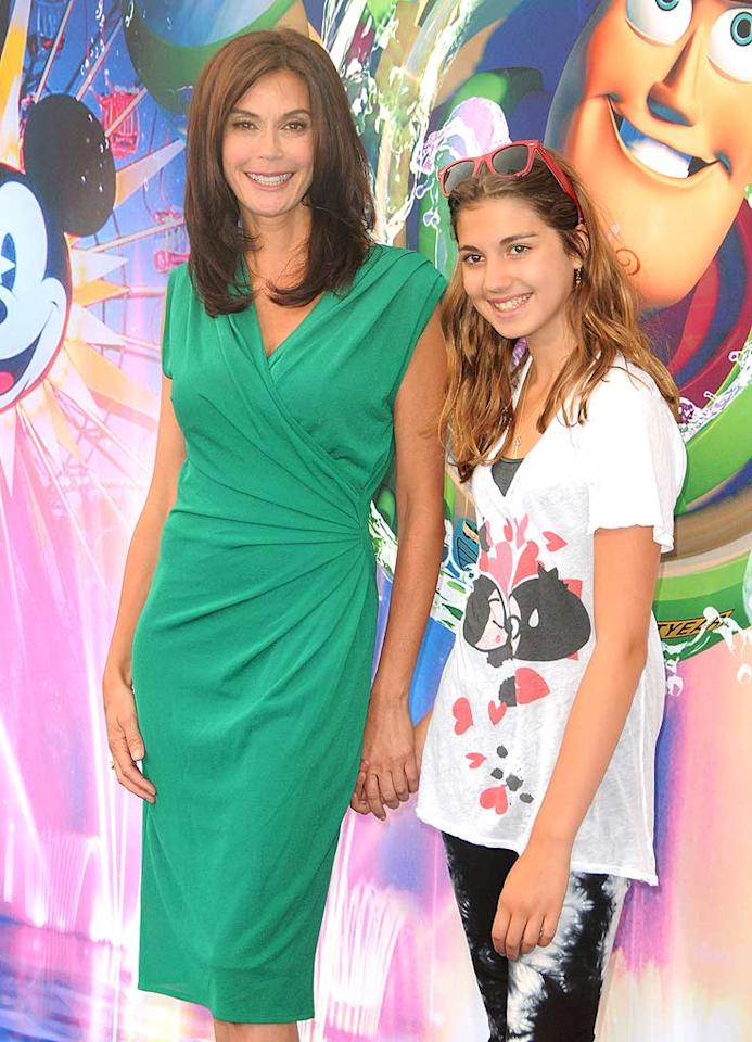 """Teri Hatcher hit up the Disney spectacular as well with her 13-year-old daughter Emerson Rose. The """"Desperate Housewives"""" star recently told Babble.com that being on her own has made her cautious about spending money. """"As a single mom, there's always a nagging feeling that this celebrity [status] could go away in a poof. You have to be conservative and smart; no Ferrari for me."""" Jordan Strauss/<a href=""""http://www.wireimage.com"""" target=""""new"""">WireImage.com</a> - June 10, 2010"""