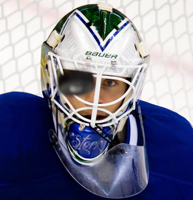 Vancouver Canucks' goalie Eddie Lack follows the puck during second period a pre-season NHL hockey against the San Jose Sharks in Vancouver, British Columbia on Monday Sept. 16, 2013. (AP Photo/The Canadian Press, Darryl Dyck)