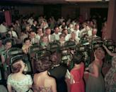 <p>Visitors flock to the slot machines in hopes of winning a quick pay out at the Desert Inn Casino in 1953. </p>