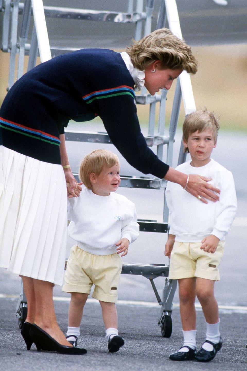 <p>Arriving at Aberdeen airport with William and Harry in matching outfits for a holiday at Balmoral Castle. </p>