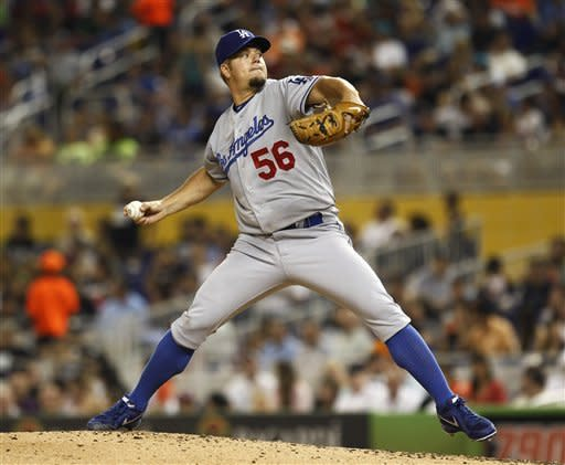 Los Angeles Dodgers starter Joe Blanton pitches to the Miami Marlins during the third inning of a baseball game in Miami, Saturday, Aug. 11, 2012. (AP Photo/J Pat Carter)