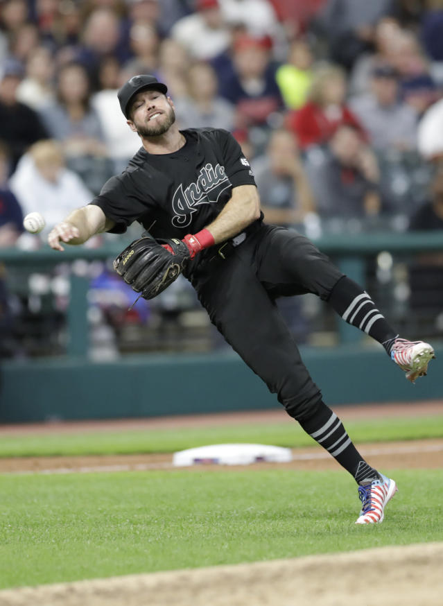 Cleveland Indians' Mike Freeman throws out Kansas City Royals' Whit Merrifield at first base during the fifth inning in a baseball game Saturday, Aug. 24, 2019, in Cleveland. (AP Photo/Tony Dejak)