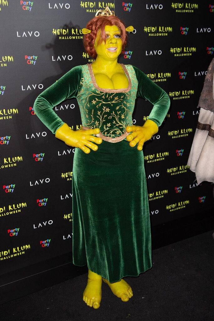 We're <em>green</em> with envy over Klum's amazing <em>Shrek</em> costume. Okay, that was a bad pun—but still, the queen of Halloween killed it yet again.