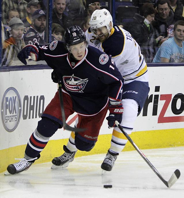 Buffalo Sabres' Henrik Tallinder, right, of Sweden, tries to steal the puck from Columbus Blue Jackets' Ryan Johansen during the second period of an NHL hockey game, Saturday, Jan. 25, 2014, in Columbus, Ohio. (AP Photo/Jay LaPrete)