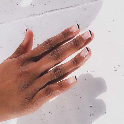 """<p>In the mood for minimalist? Bright black and white tips will do just nicely.</p><p><a href=""""https://www.instagram.com/p/B53VpvtH0YY/"""" rel=""""nofollow noopener"""" target=""""_blank"""" data-ylk=""""slk:See the original post on Instagram"""" class=""""link rapid-noclick-resp"""">See the original post on Instagram</a></p>"""