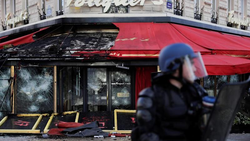 Massive police presence for Paris as shops close over strike violence fears