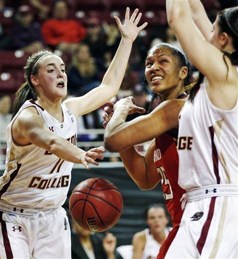 Boston College guard Nicole Boudreau, left, strips the ball from Maryland forward Alyssa Thomas during the first half of an NCAA college basketball game in Boston, Thursday, Feb. 21, 2013. (AP Photo/Charles Krupa)