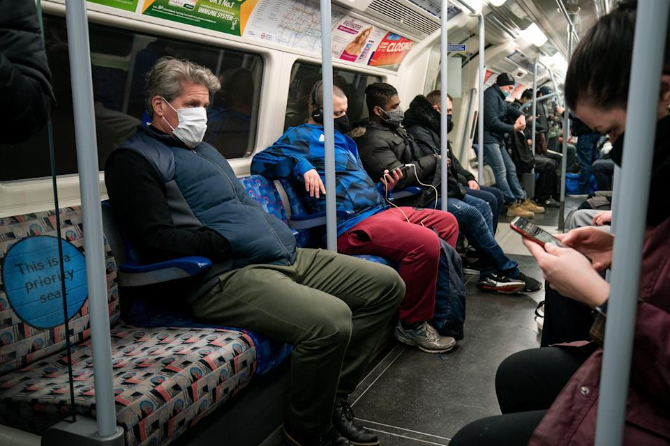 Commuters in London will have to continue to wear face coverings after so-called 'freedom day' (PA Wire)