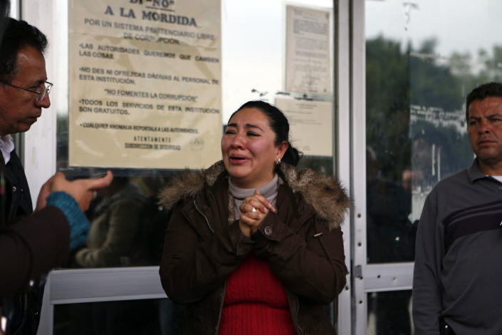 """Michelle Valadez, 34, whose husband Ignacio was kidnapped, held for three months and killed in 2005, allegedly by the gang led by the Mexican then boyfriend of Frenchwoman Florence Cassez, cries outside a prison where Cassez had been held in Mexico City, Wednesday, Jan. 23, 2013. A Mexican Supreme Court panel voted Wednesday to release Cassez, a Frenchwoman who says she was unjustly sentenced to 60 years in prison for kidnapping and whose case became a cause celebre in France, straining relations between the two countries. A police convoy with sirens flashing escorted a white sports utility vehicle out of the prison where Cassez had been held later Wednesday, presumably carrying her to the Mexico City airport. Relatives of kidnap victims angrily shouted """"Killer!"""" as the vehicle pulled away. (AP Photo/Andres Leighton)"""