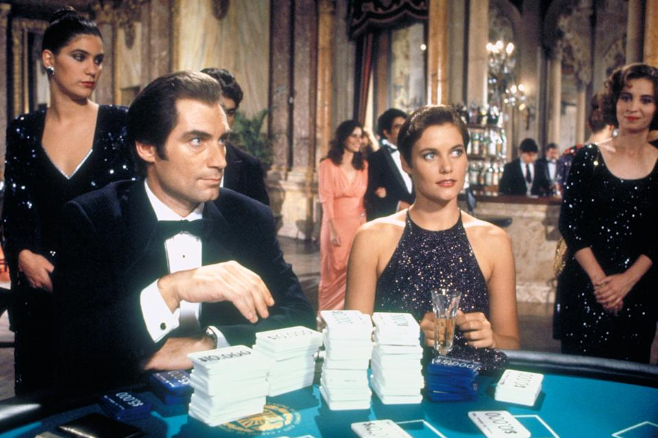 British actor Timothy Dalton and American actress Carey Lowell on the set of Licence to Kill, directed by John Glen. (Photo by Sunset Boulevard/Corbis via Getty Images)