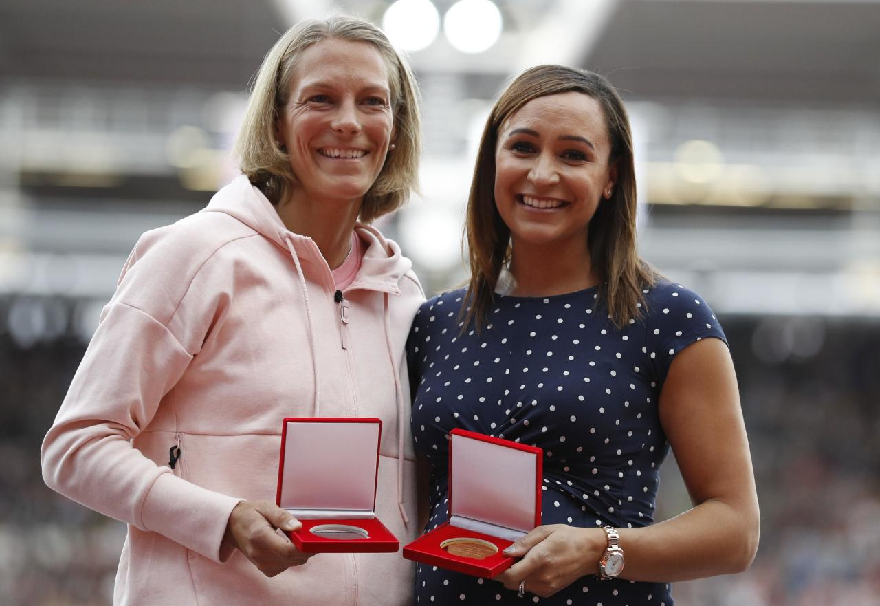 Athletics - World Athletics Championships – London Stadium, London, Britain - August 6, 2017. Jessica Ennis-Hill of Great Britain is presented a gold medal and Jennifer Oeser of Germany with bronze in the Women Heptatlon from the 2011 Daegu World Championships. REUTERS/Phil Noble