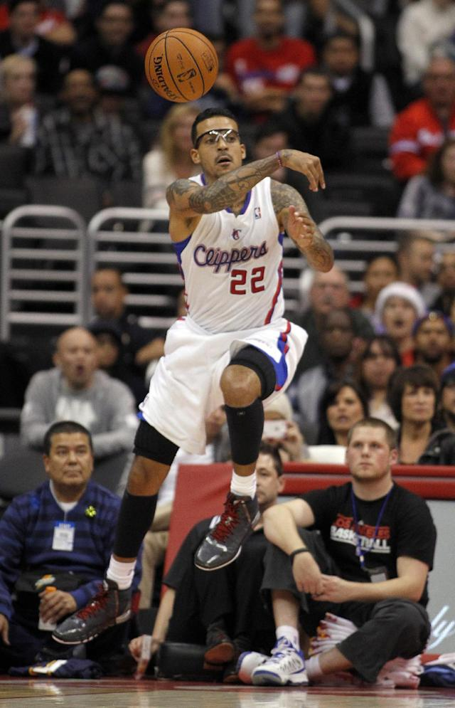Los Angeles Clippers forward Matt Barnes (22) saves the ball from going out of bounds in the first half of an NBA basketball game against the Denver Nuggets in Los Angeles on Saturday, Dec. 21, 2013. (AP Photo/Alex Gallardo)