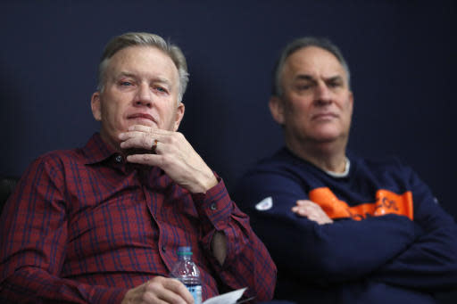 Denver Broncos general manager John Elway, left, and head coach Vic Fangio listen at as quarterback Joe Flacco speaks news conference at the NFL football team's headquarters, Friday, March 15, 2019, in Englewood, Colo. (AP Photo/David Zalubowski)