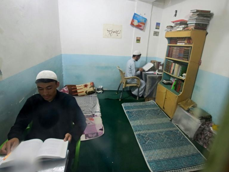 While members of Afghanistan's Hazara community feel safe in Najaf for now, they fear for their families back home (AFP/Ali NAJAFI)